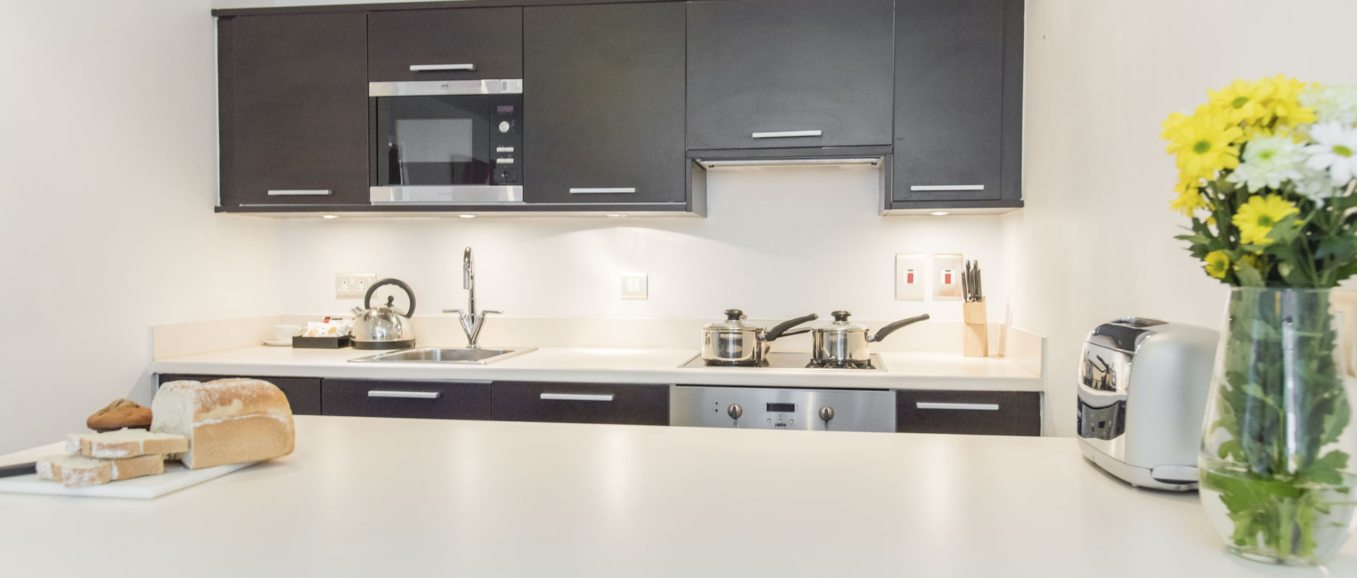 Modern fully equipped kitchen in PREMIER SUITES Liverpool serviced apartments