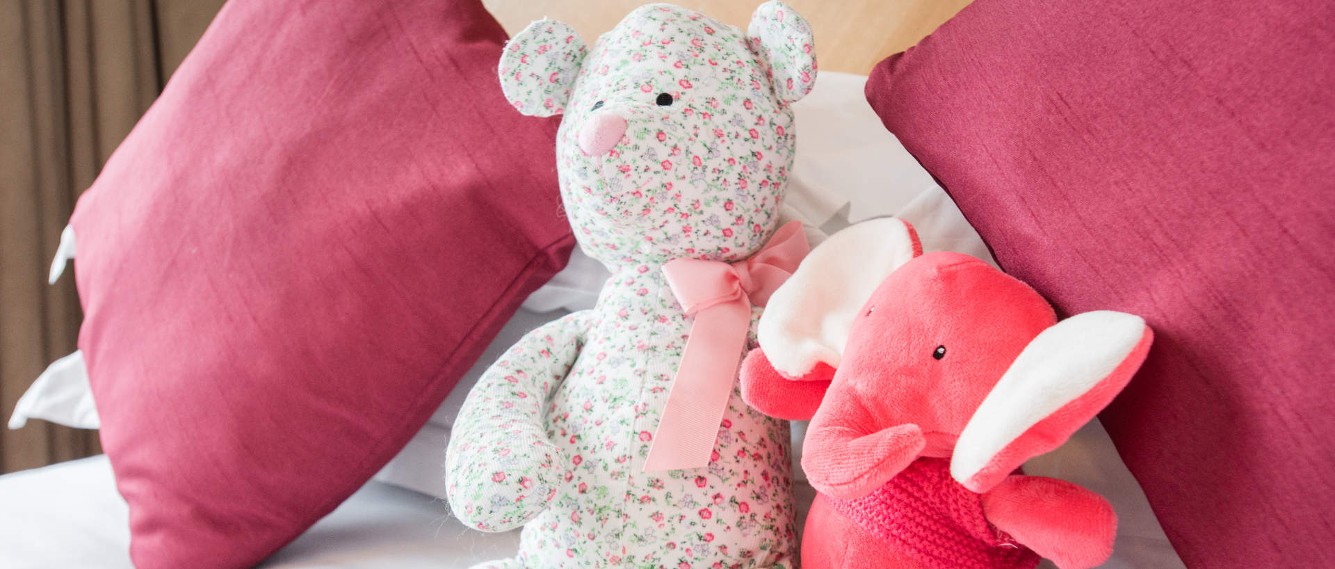 Teddies on the bed of PREMIER SUITES Manchester family serviced apartment