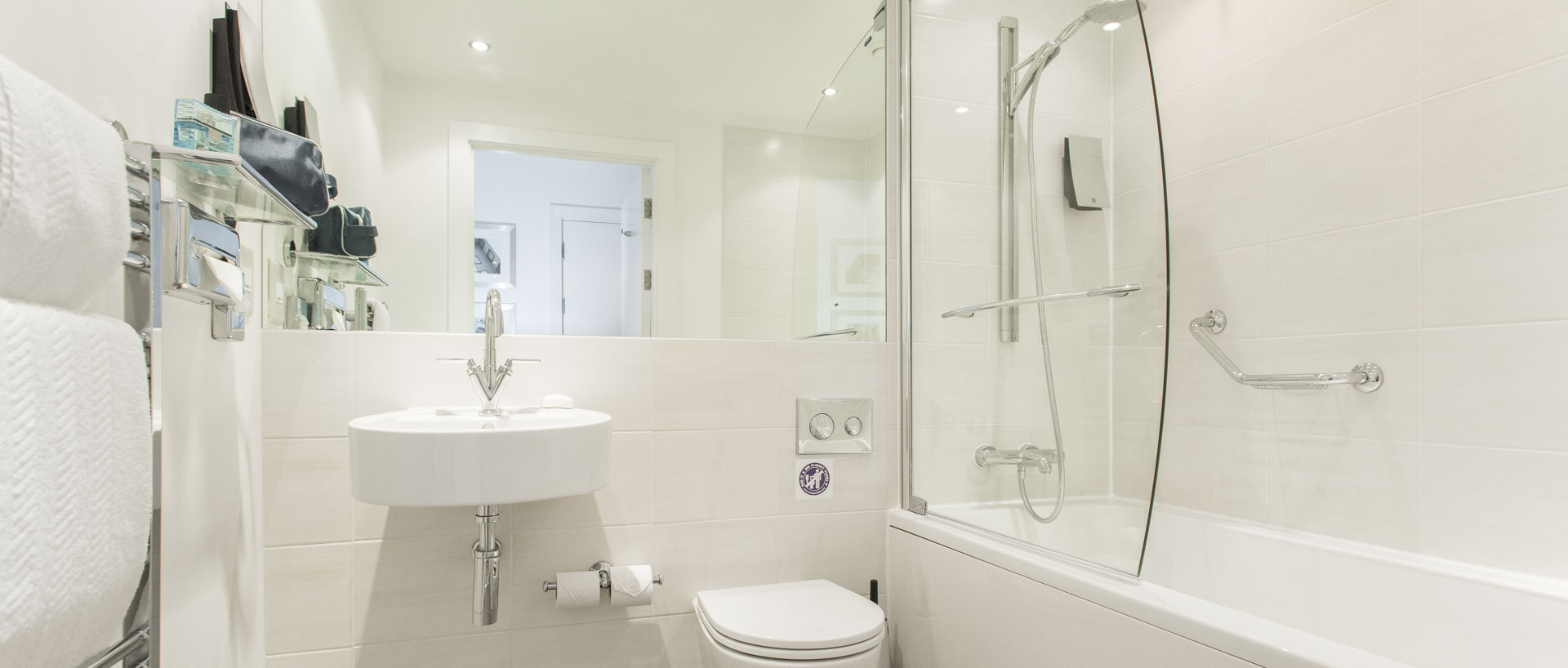 Large bright spacious bathroom in PREMIER SUITES Manchester